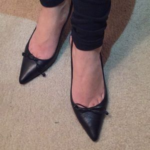 Delman black leather sling backs